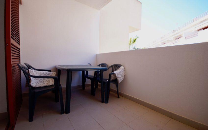 Fin leilighet med felles svømmebasseng i hjertet av Playa Flamenca